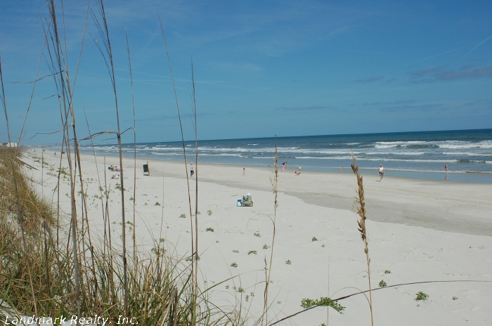 Crescent is a wide sandy beach with high dunes.
